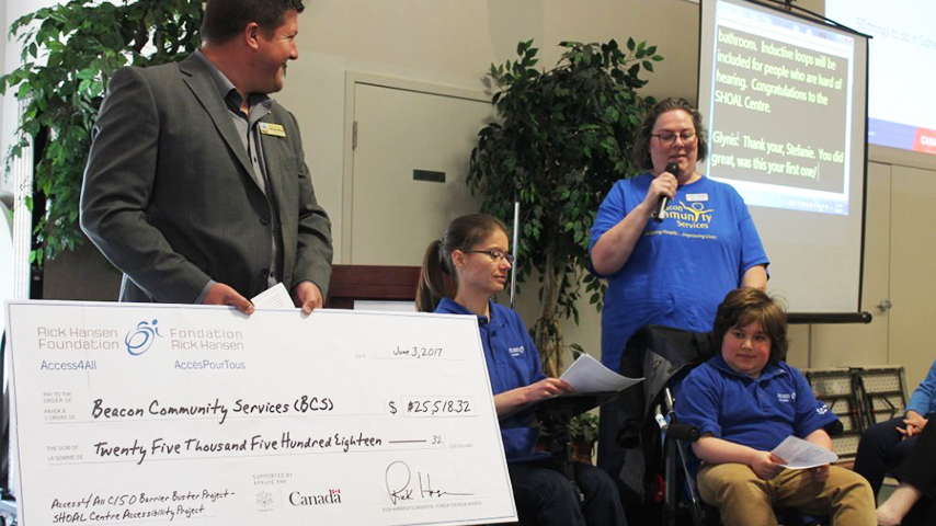 SHOAL Centre team members shows the grant cheque
